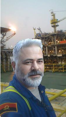 A PhotoShop Image of an Innocent Man on an Oil Rig Used by Nigerian Scammers